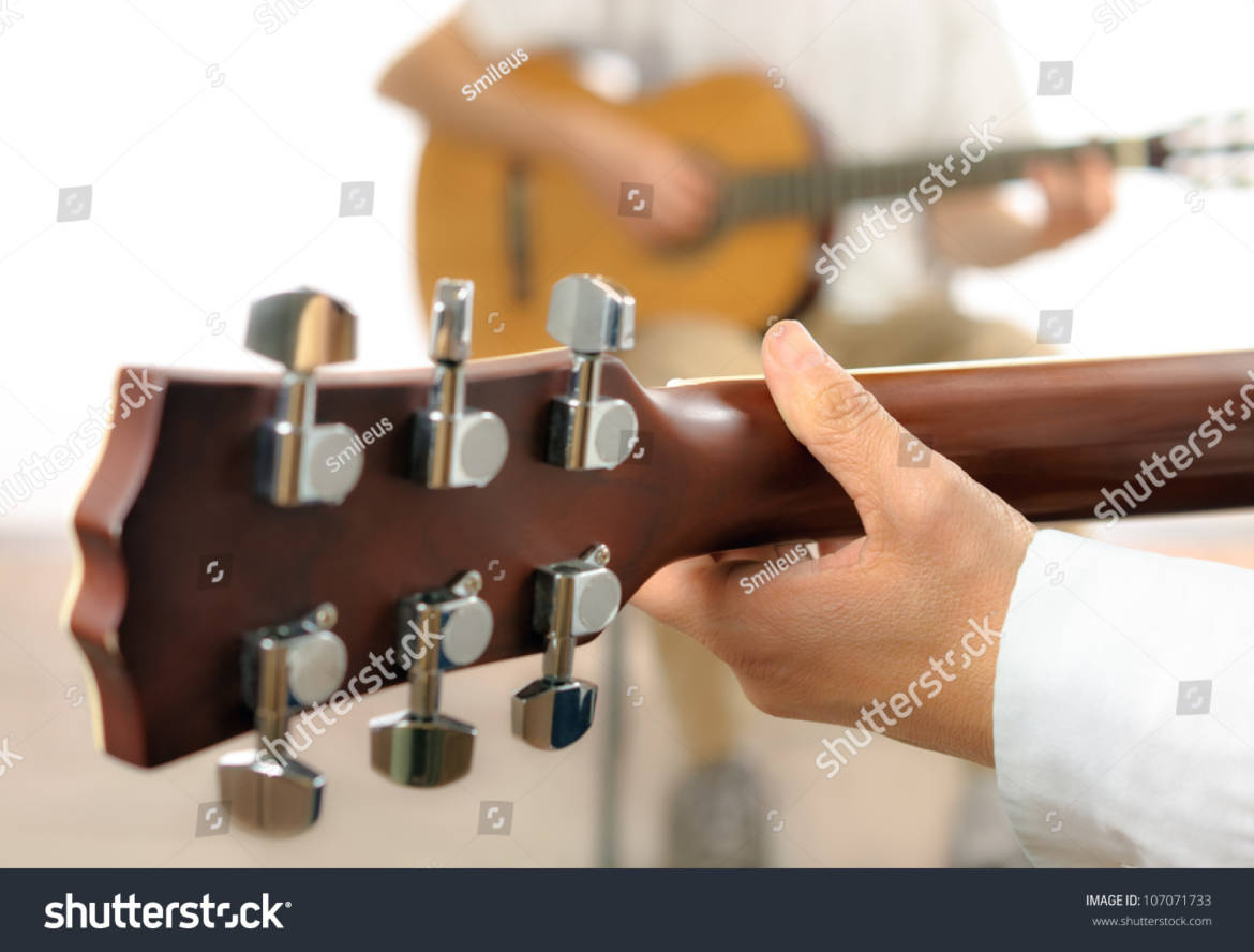 stock-photo-guitar-lesson-or-two-musicians-playing-together-shot-from-behind-one-guitar-with-shallow-focus-107071733.jpg
