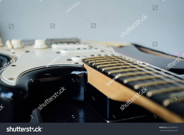 stock-photo-guitar-on-table-624529919.jpg