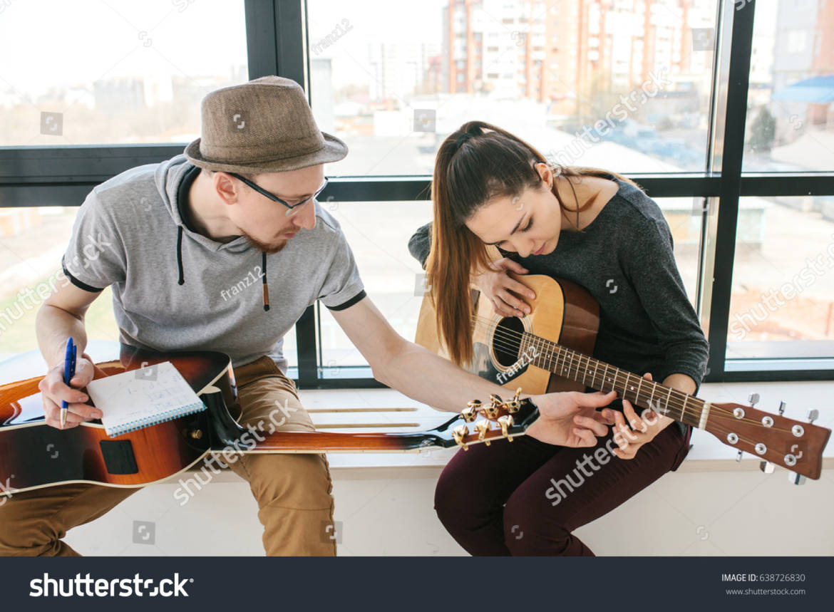 stock-photo-learning-to-play-the-guitar-music-education-638726830.jpg