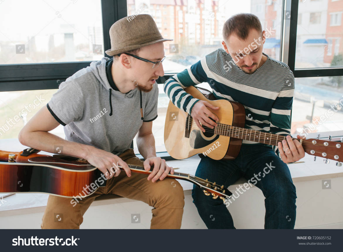 stock-photo-learning-to-play-the-guitar-music-education-720605152.jpg